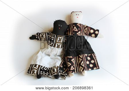 White doll with arm over shoulder of black doll concept inclusion, isolated on white