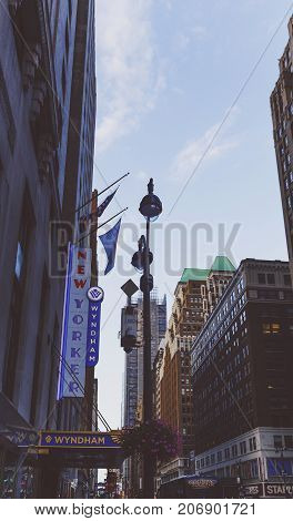 NEW YORK NY - September 3rd 2017: Detail of a Midtown street with New Yorker hotel sign and surrounding buildings