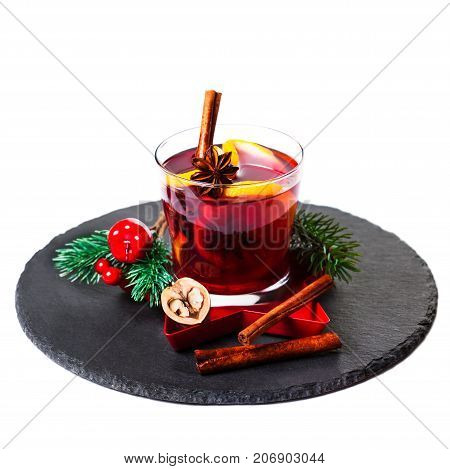 Christmas Hot mulled wine for winter with spices isolated on white background traditional drink on winter holidays closeup. Mulled wine or gluhwein composition with Christmas Decorations