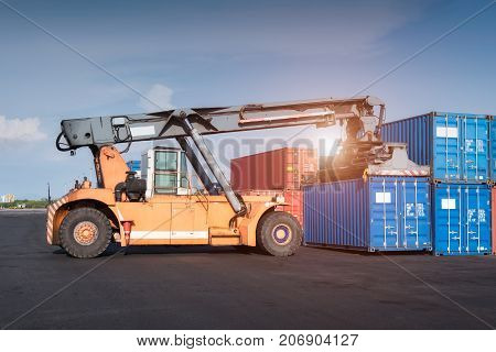 Forklift Truck Lifting Cargo Containers In Shipping