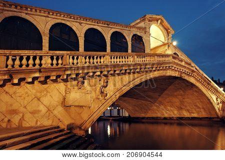 Rialto Bridge or Ponte di Rialto over Grand Canal at night in Venice, Italy.