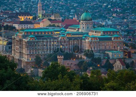 Budapest Hungary - The beautiful Buda Castle Royal Palace with the Buda hills and the Matthias Church at background at magic hour