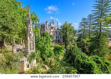 Aerial view of beautiful landscape of Regaleira Palace in Sintra, Portugal. Sunny day, blue sky.