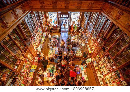 Oporto, Portugal - August 13, 2017: aerial view of crowd of people in Library Lello and Irmao, one of the major tourist attractions for Harry Potter fans. Rua das carmelitas in Porto historic center.
