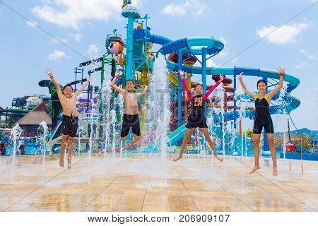 Pattaya Thailand - 1 May 2016 - Children jump up happily at a water fountain at Cartoon Network Amazone Water Park in Pattaya Thailand on May 1 2016.