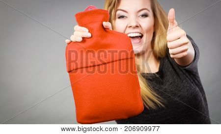 Happy Woman Holds Hot Water Bottle