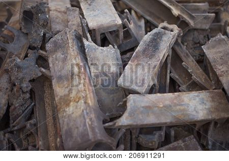 Pile of burnt-out cast iron parts of the industrial firebox.