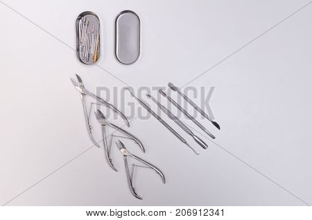 Set For Manicure Tools. White Background. Space For Text