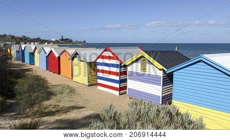 Colorful huts on Melbourne's iconic Brighton Beach, a must see location when holidaying in Australia
