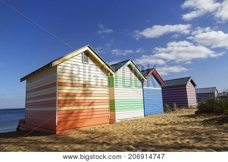 The iconic colorful bathing huts on Melbourne's Brighton Beach with beautiful blue skies