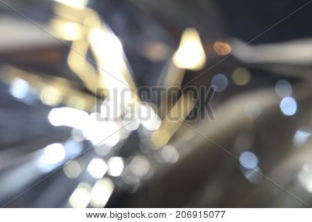 evening blurred abstract background with light spots similar to falling