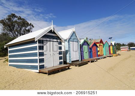 Brighton Beach, Australia: March 31, 2017: The colorful beach huts on Brighton Beach in Melbourne with a blue sky background. A sightseeing destination when traveling in Australia.
