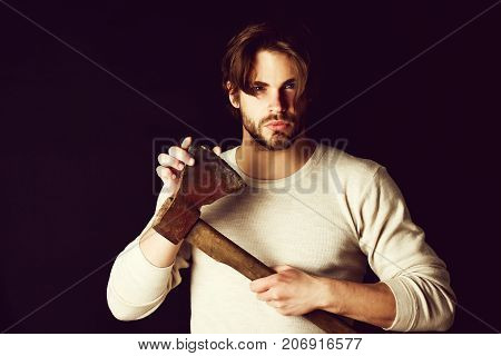 Assured Young Man Checking Sharpness Of His Old Axe