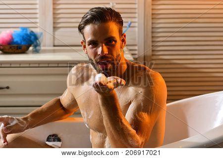 Guy In Bathroom Covered With Foam Blowing Foam