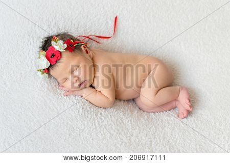Sweet girl in bright Ukrainian colorful hairband a