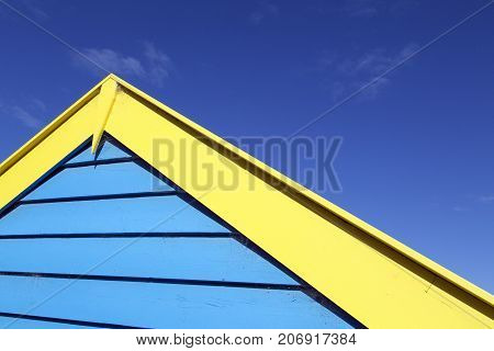 Roof apex of one of the beach huts on Melbourne's Brighton Beach with a summer blue sky background