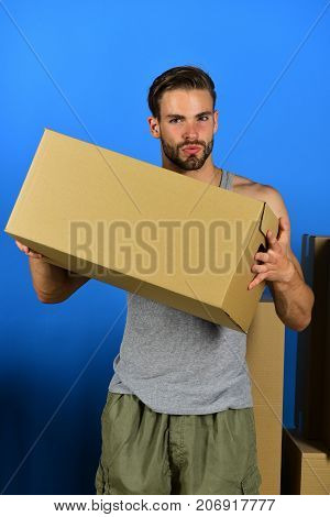 Guy Standing With Cardboard Box Isolated On Blue Background