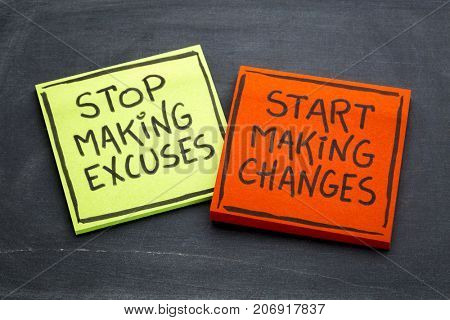 Stop making excuses, start making changes - handwriting on sticky notes against slate blackboard