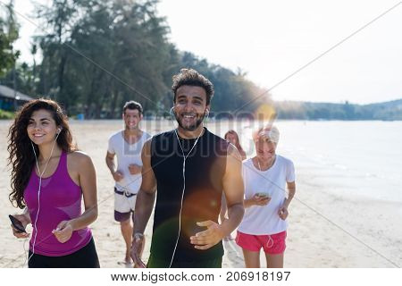 Group Of People Running, Young Sport Runners Jogging On Beach Working Out Smiling Happy, Fit Male And Female Joggers Multiracial Team