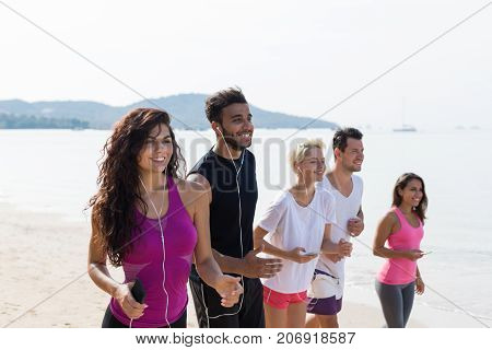 Group Of People Running, Young Sport Runners Mix Race Jogging On Beach Working Out Smiling Happy, Fit Men And Women Joggers Multiracial Team