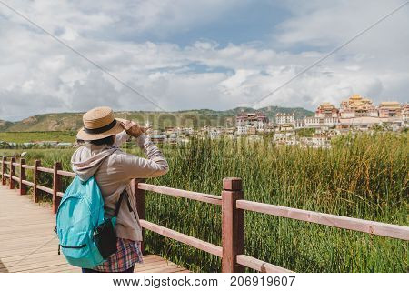 Female tourists are traveling in Little Potala Palace Lamasery The famous temple in shangri-la yunnan china
