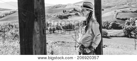 Smiling Woman Hiker In Tuscany Looking Into Distance