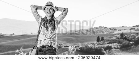 Relaxed Woman Hiker Enjoying Tuscany View Looking Into Distance