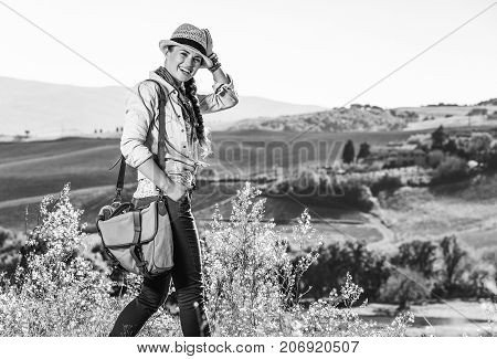 Smiling Active Woman Hiker In Hat Enjoying Tuscany View