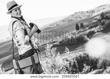 Smiling Adventure Woman Hiker Hiking In Tuscany With Binoculars