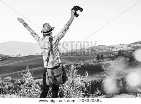 Woman Hiker Hiking In Tuscany With Binoculars Rejoicing
