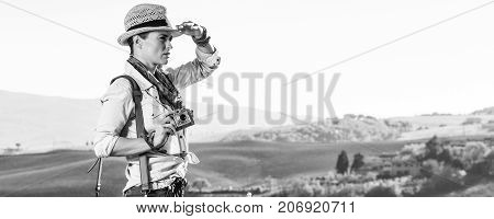 Woman Hiker With Vintage Photo Camera Looking Into The Distance