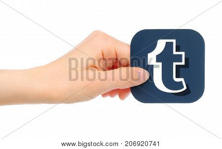 Kiev Ukraine - May 18 2016: Hand holds Tumblr icon printed on paper. Tumblr is a well-known social networking and news service