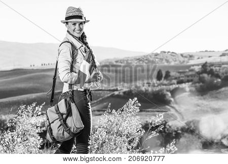 Happy Active Woman Hiker With Italian Flag Hiking In Tuscany