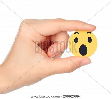 Kiev Ukraine - September 04 2017: Hand holds Facebook Wow Empathetic Emoji Reaction printed on paper. Facebook is a well-known social networking service