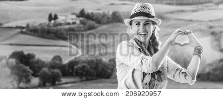 Woman Hiker In Tuscany Showing Heart Shaped Hands