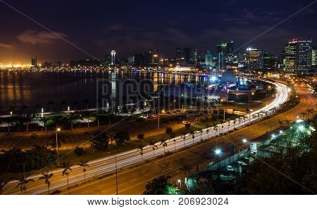 Skyline of capital city Luanda and its seaside during the night, Angola, Africa.
