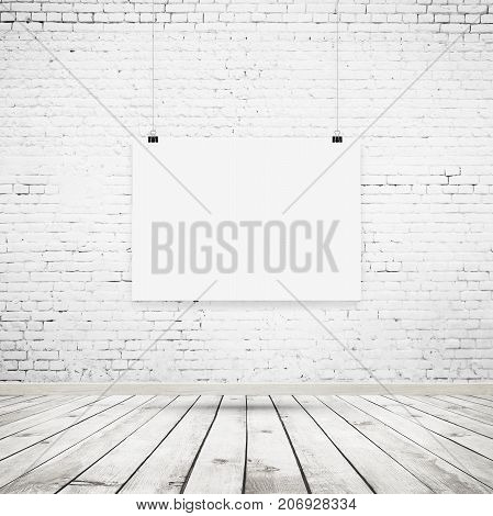 White blank poster mockup with binders in interior with brick wall and wooden floor
