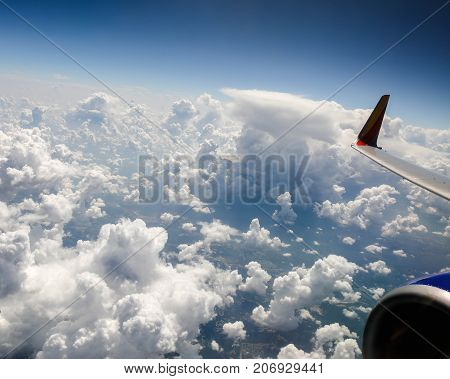 A wonderful view with blue skies and white puffy clouds while riding on an airplane