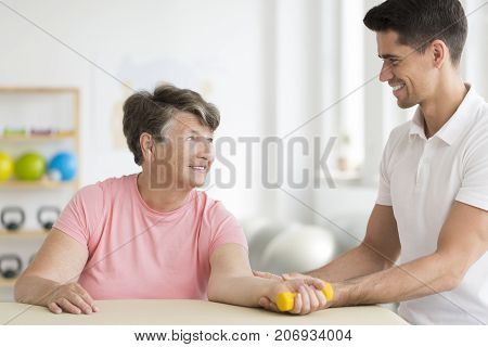 Physical Therapist Supporting His Ward