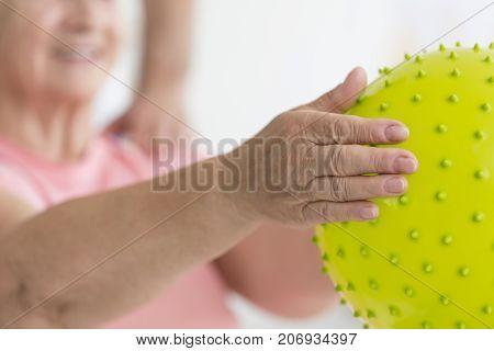 Hands Holding Massage Ball