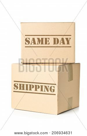 Two corrugated cardboard carton parcels with Same Day Shipping imprint