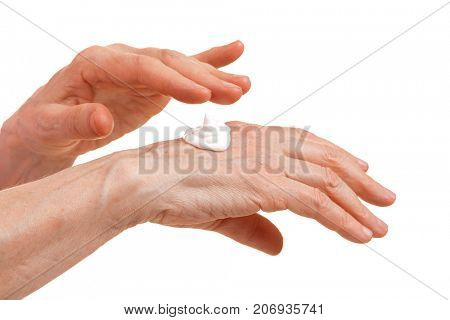 Hands of an elderly woman with moisturizing cream. Care of the old skin. Isolate on a white background.