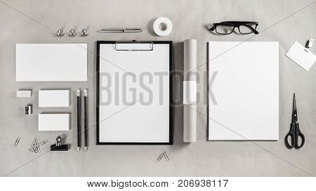 Corporate identity template. Photo of blank stationery set on craft paper background. Mockup for branding identity. Top view.