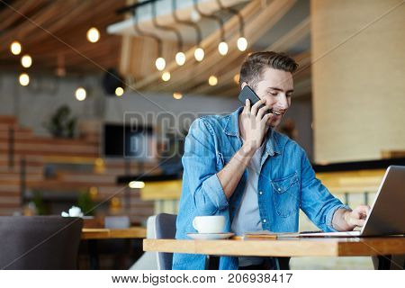 Jobless guy looking for vacancies in the net and phoning to make appointments with employers