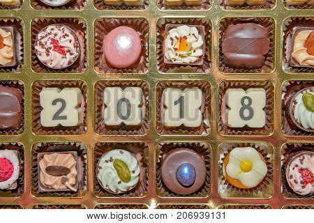 Chocolate sweets and candies with 2018 new year sign