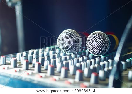 two microphones on the soundmixer in the nightclub
