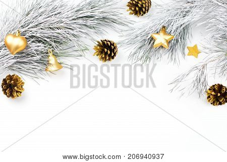 Christmas border with fir branches, conifer cones, christmas balls and golden christmas ornaments on white background, copy space