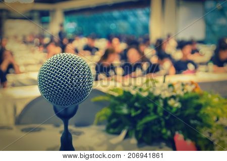 Microphone over the Abstract blurred photo of conference hall or seminar room with attendee background business seminar concept