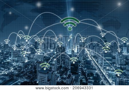 Network connection line between building over the top view of Bangkok Cityscape at night Mahanakhon and world map background which dicut each elements cool tone color network and connection concept, 3D illustration