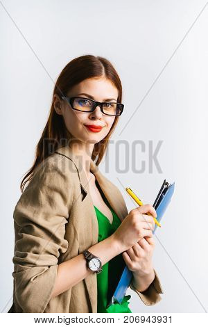 girl secretary on a white background holds a file by making notes in it